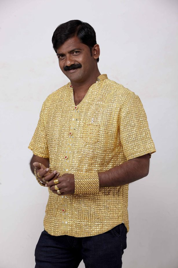 PAYDatta-Phuge-wearing-solid-gold-shirt