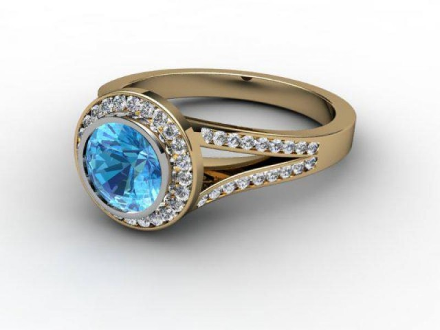 Natural Blue Topaz and Diamond Ring. 18ct Yellow Gold